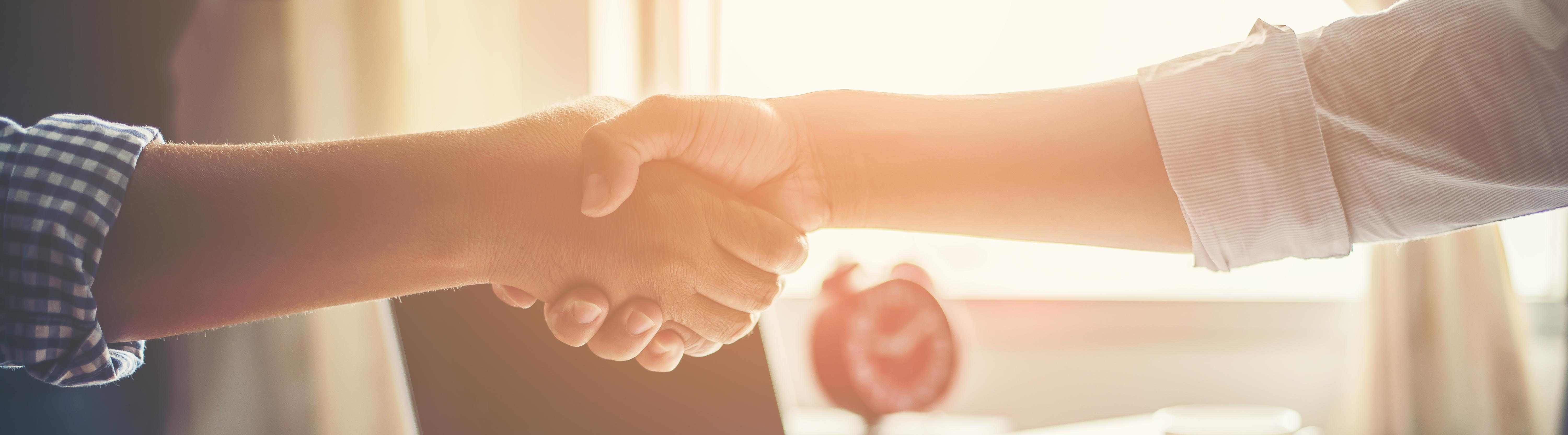 Business People Handshake Greeting Deal at work.